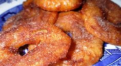 Apple Fritter Rings~~~Thin rings of apples are dipped into a sweetly seasoned cinnamon and nutmeg batter and then fried. Best served hot!