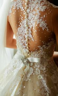 Gorgeous beaded, net and lace wedding dress