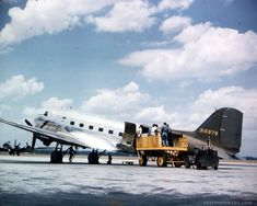 Crew prepares to load cargo on a Douglas C-47 at Patterson Field, Ohio. A guard is standing by the tail of the plane.