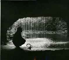 Ranger and conservationist Roscoe Nicholson crouches in a century-old railroad tunnel near Clayton, Rabun County, Georgia, March 15, 1953. :...