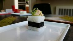 Sushi cube with salmon seaweed salad