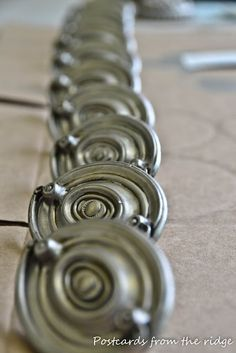 Turn Brass handles to pewter using Modern Masters mettallic paints in 'silver' and 'warm silver'.