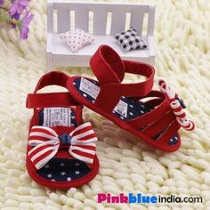 Shop amazing pair of sandal in the combination of red and blue with a soft and tender base for her delicate feet.