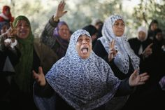 GAZA FUNERAL: Relatives mourned 22-year-old Odah Hamad in Beit Hanoun, in the northern Gaza Strip, Friday. Palestinian officials blamed Isra...