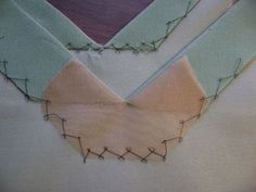 Sewing technique from Susan Khalje: create a mini-facing using silk organza to get corners that don't fray.