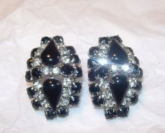 These earrings are very elegant. Brilliant rhinestones surround two teardrop shaped stones and are surrounded by more black stones in a