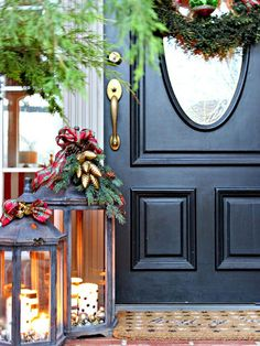Add the soft glow of candlelight to your front porch with decorated lanterns. Jennifer of Dimples and Tangles filled hers with ornaments and topped them with beautiful bows and greenery./