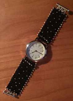 Black and silver watch band