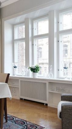 dustjacket attic: A Stockholm Apartment Good Rad cover treatment Diy Radiator Cover, Radiator Ideas, Bay Window Living Room, Old Radiators, Stockholm Apartment, Interior Inspiration, Family Room, Sweet Home, New Homes