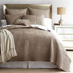 Time to give your bedding a proper upgrade? Our Essex linens impress for all the right reasons. Made of supremely soft satin, the hand-quilted, ripple-wave pattern is subtly sophisticated in a rich taupe. Comforter Sets, Brown Bedding, Linen Duvet, King Comforter, Linen Pillows, Taupe Bedroom, Bedding Master Bedroom, Lineup, Houses