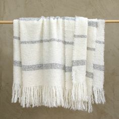 Super-soft, warm blanket woven from Stansborough Grey and New Zealand Mohair wool in New Zealand. Stansborough's luxurious wool throws are woven at their Wellington Mill on looms dating from the early 1890's. Among the first mechanical looms designed, they can take up to two days to hand thread in preparation for weaving. Most often set tightly to create intricate designs, they can also be set more loosely to weave open patterns. The resulting throws have a unique, handmade and natural feel…