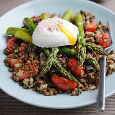 warm british asparagus and lentil salad with poached eggs