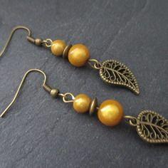 Jolie paire de boucle d'oreilles métal couleur bronze