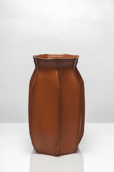 Plumber's Piece is the result of experimentation with leather and inspired by the shape of membranes (rubber balloons) from expansion tanks.The constructive value of leather combined with the flexible rubber membrane creates a new visual language. The shape of Plumber's Piece originates from the proportions of the existing membrane. The ribs give the material structural value, so that the vase remains in balance and the original properties of both materials are accentuated.