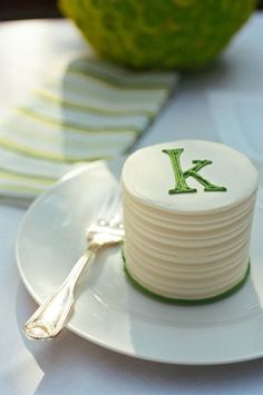Katy - I love this monogrammed mini cake for the bride and groom to cut to go with cupcakes!!