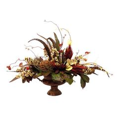 Faux floral arrangement in a footed vase. Product: Faux floral arrangement Construction Material: Silk ...