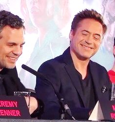 "Robert looking at Elizabeth Olsen after she says nice things about him at the ""Age of Ultron"" L.A. press conference."
