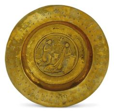 A NUREMBERG BRASS ALMS DISH -  LATE 15TH EARLY 16TH CENTURY
