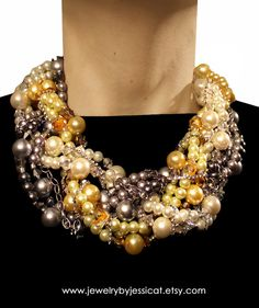 Be the talk of the town, with this totally unique, bold, and edgy statement necklace in bright yellows, grays, and ivories. Entire necklace is wrapped with silver metal and rhinestone chains!      GRAND TWISTED Statement Necklace Gray Yellow by JewelryByJessicaT,