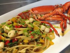 Springtime Specials from the Seashore at Tanino Ristorante!  1/2 fresh Maine lobster with Bay Scallops, Jalapeño, Bell Peppers, Creamy Avocado and Fresh Scallions in a White Wine Garlic Sauce.