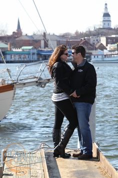 Annapolis Engagement Photography couple on the pier overlooking Annapolis harbor