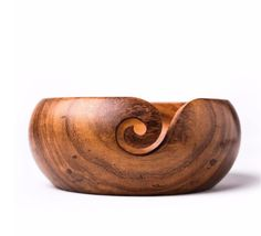 "Yarn Bowls!! Who does not want a piece of art to use while making art? These wooden yarn bowls are handmade out of Sheesham wood. Approximate Dimensions: Diameter: 5"" Height: 2.5"""