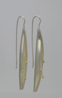 Lona Northener earrings of sterling and 24K gold.