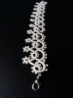 "Tatted bracelet ""Tatted bracelet, made pattern for."", ""Tatting: Edging or jewlery - bracelet"", ""Edging as a bracelet. Very pretty in plain white! Bracelet Tatting, Tatting Earrings, Tatting Jewelry, Bracelet Crafts, Tatting Lace, Bracelets, Shuttle Tatting Patterns, Needle Tatting Patterns, Lace Patterns"