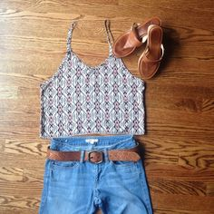 Brandy Melville Crop Top/ Tank Top Brandy Melville Crop/Tank Top One Size. On trend tribal print makes this crop perfect for warmer weather! Very Good Used Condition, one minor flaw as noted above in the last photo. Brandy Melville Tops Crop Tops
