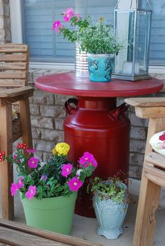 A old milk can and piece of wood...alll painted red...for a great table.  i love the idea and the color!  Don't paint but use Dad's antique, labeled milk can for plant display