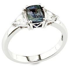 A fine cushion cut Brazilian #Alexandrite is flanked by a pair of perfectly matched trillion cut white diamonds in this delicate classic style ring by @David Wein