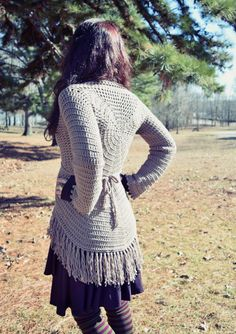Free crochet pattern for loose, flowing sweater with a swirl design on the back and tie waist #freecrochetpatterns #sweater #crochet