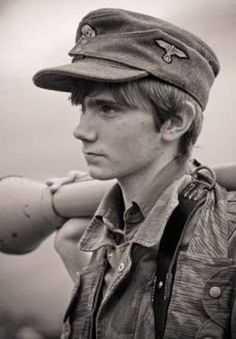 Boy German Waffen-SS soldier holding Panzerfaust, one of the first anti-tank weapons which took great bravery to use! World History, World War Ii, German Army, German Men, German Boys, German Soldiers Ww2, Hiroshima, Military History, Historical Photos