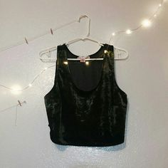 NWOT UO Crop Top NWOT velvet and mesh crop top from URBAN OUTFITTERS! Brand is Band of Gypsies.  Front side is a dark green/emerald/almost black velvet, and the entire back side is a black mesh screen. Never been worn.  Looks great if worn loose by someone who is a smaller size, and also looks great when it fits to size. Urban Outfitters Tops Crop Tops