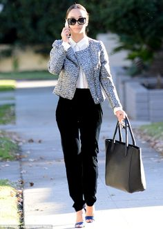 Elegant: On Wednesday Cara was the epitome of ladylike chic in a tweed jacket which she wore over a crisp white shirt and black trousers