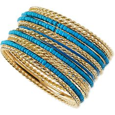 "Jules Smith. Beaded Golden Bangles, Set of 13. Jules Smith set of 13 bangle bracelets. Golden metal with blue coating and resin beads. Approx. 2.5"" diameter. But it cost 1500"