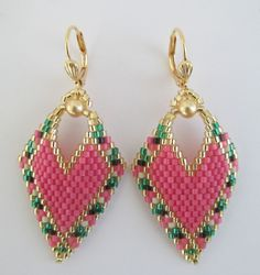 These earrings are my own original pattern. Copyright 2016 Patti Ann McAlister  *You will receive a FREE surprise pair of acrylic baroque cabochon earrings as shown in last photo, which measure 1-3/8 long x 3/4 wide.*  These pretty earrings are slightly concave & are handmade with Duracoat Silver-lined frost hibiscus pink, opaque black, matte bone, silver-lined emerald green, & golden delica seed beads, with 4mm golden Swarovski glass pearls. They measure just about 2 long i...