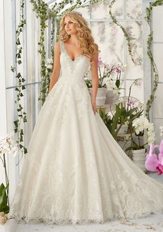 Diamante Beading Edges the Tulle Ball Wedding Dress Decorated with Wispy, Embroidered Lace Appliques and Deep Scalloped Edging.