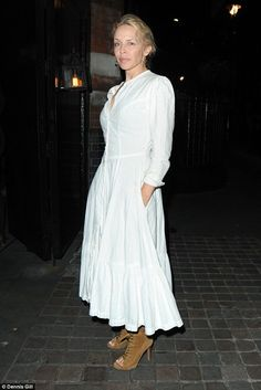 Always stylish: Looking good, the 48 year-old opted for a boho-inspired white dress which featured turned-up sleeves and a flowing hem