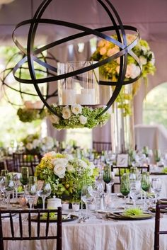 Now this is an amazing idea for a reception. It ushers in a eye catching chandelier alternative, flowers and candles to make this easy to transition from day to night. #wedding #reception #districtfete #weddingplanner
