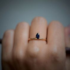 Drop-shaped sapphire set in 14K solid yellow gold