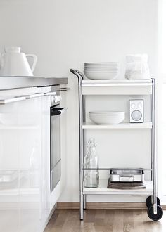White high gloss cabinets with large satin nickel pulls