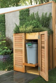 green roof and vertical green walled rubbish area