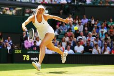 Maria Sharapova Photos - Maria Sharapova of Russia during her Ladies' Singles fourth round match against Angelique Kerber of Germany on day eight of the Wimbledon Lawn Tennis Championships at the All England Lawn Tennis and Croquet Club on July 1, 2014 in London, England. - Wimbledon: Day 8