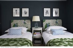 Bed Headboards in Christopher Farr Carnival in Green. Pillows in Quadrille China Seas Java Java in Blue.