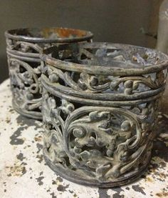 Beautiful old sculpted metal containers....