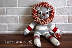 Sew a cute sock lion, Shimba, from a pair of socks with this free pattern and tutorial. Step by step photo with detailed directions given.