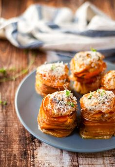 """Cheesy sweet potato stacks- kind of like scalloped potatoes, thin slices are baked in a creamy sauce & served hot. """"Our stacks had a touch of thyme, and crisped up along the edges."""" Ooooh, these look so delicious & would be a great meal for the cold fall & winter months."""