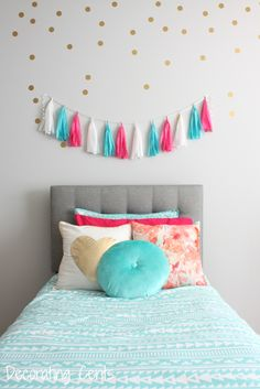girls room - tufted headboard, gold polka dots, tassel garland