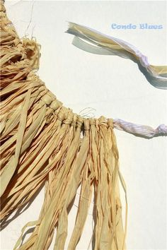 A step by step tutorial how to make a quick and easy no sew tropical Hawaiian grass skirt.